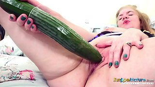 Some big ass cucumber for an old woman's hungry pussy
